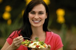 woman smiling eat a salad